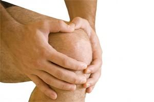 man having pain in his knee making massage